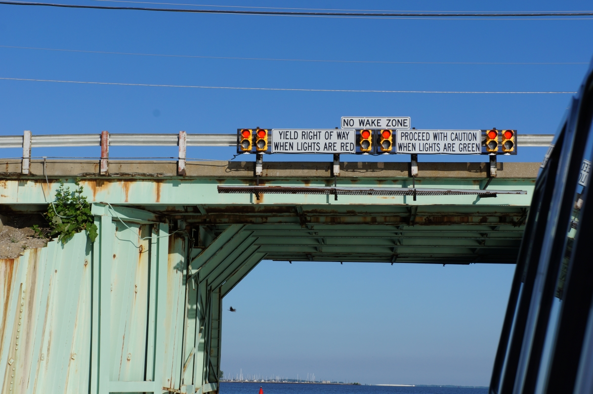 A bridge with signals and signs saying