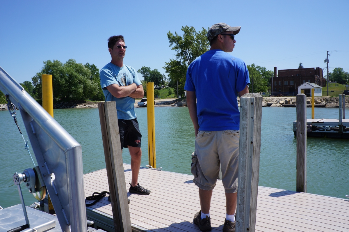 Two people standing on a dock