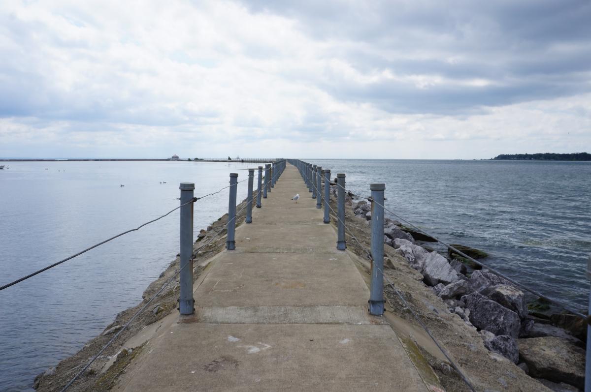 A pier walkway between two bodies of water