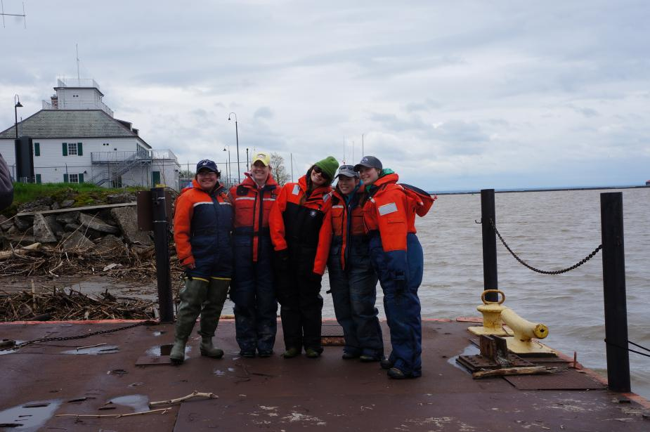 Five students from the fisheries class pose on the dock in their flotation suits.