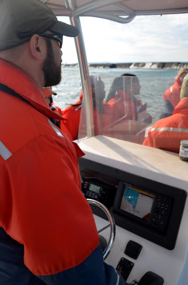 A person at the console of the boat.