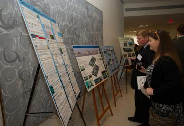 Two guests view posters discussing Great Lakes Center projects.