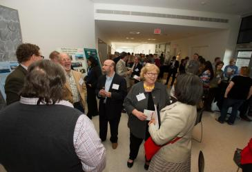 Many guests mingle during the 50th anniversary reception.