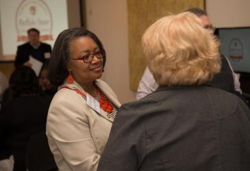 President Katherine Conway-Turner talks with another woman at the 50th anniversary reception.