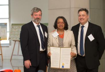 Dr. Alexander Karatayev, President Katherine Conway-Turner, and State Senator Mark Panepinto. President Conway-Turner is holding a proclamation given to Buffalo State by Senator Panepinto.