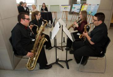 A saxophone quartet entertains guests at the reception.
