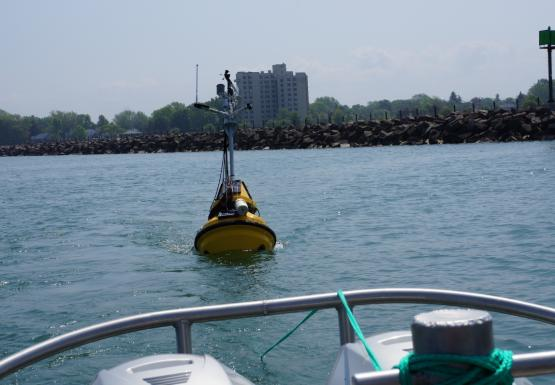 A buoy is being towed behind a boat.