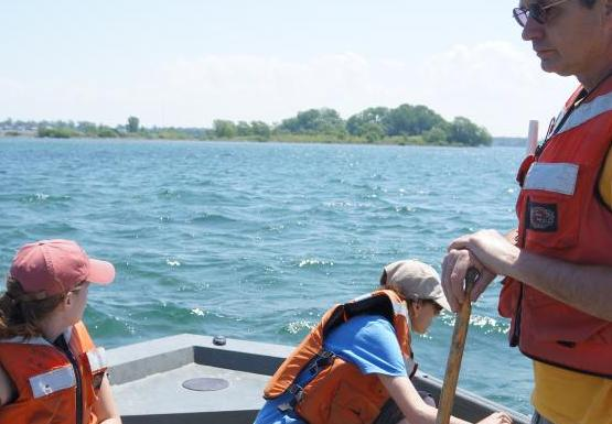 A student, Dr. Pérez, and Mark scouting on the Niagara River