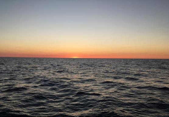 Sunrise or sunset over water