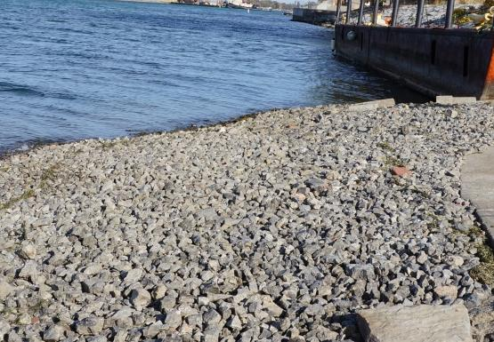 exposed gravel at the end of the boat ramp