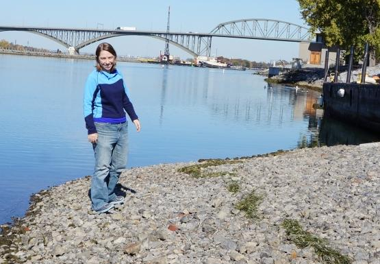 Katie stands on the exposed gravel at the end of the boat ramp