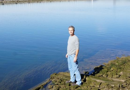Mark stands on the exposed dock pilings