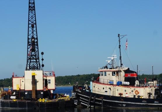 Army Corps tug and barge working on the Bird Island Pier
