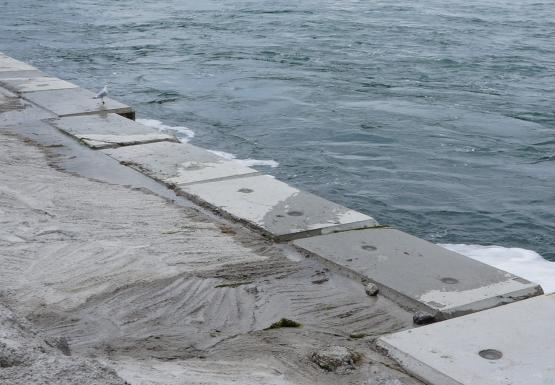Blocks and concrete along the pier in the river