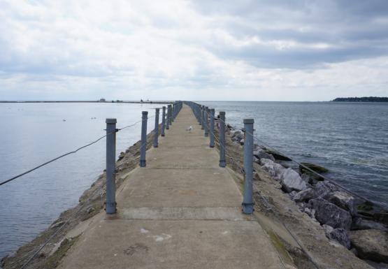 A pier walkway between two bodies of water