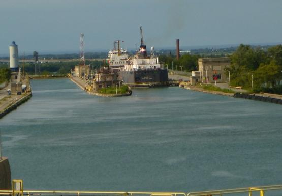 A large freight boat in a large canal lock