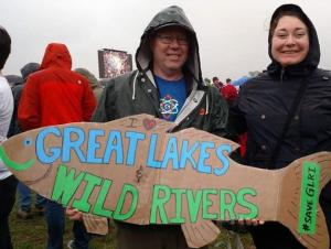 "Two people pose at the March for Science with a sign that is shaped like a fish and says, ""I <3 Great Lakes and Wild Rivers #saveGLRI."" Photo credit: Candice Brothers"