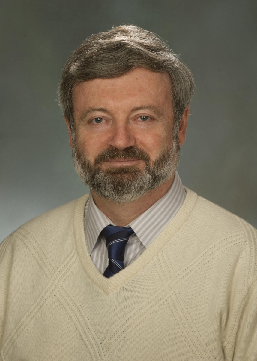 A color portrait of Dr. Alexander Karatayev in a sweater and tie