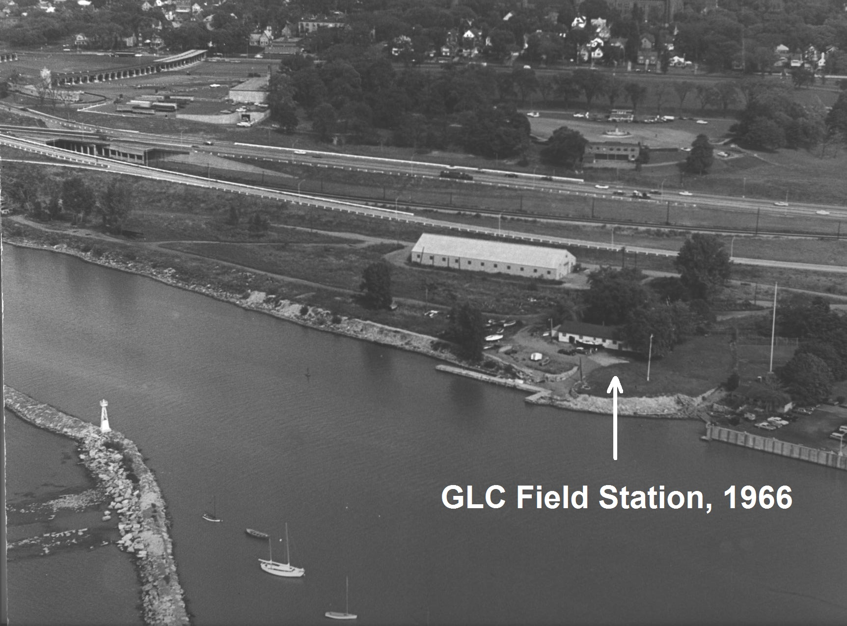 "Black & white aerial photo of a waterfront building. ""GLC Field Station, 1966"""