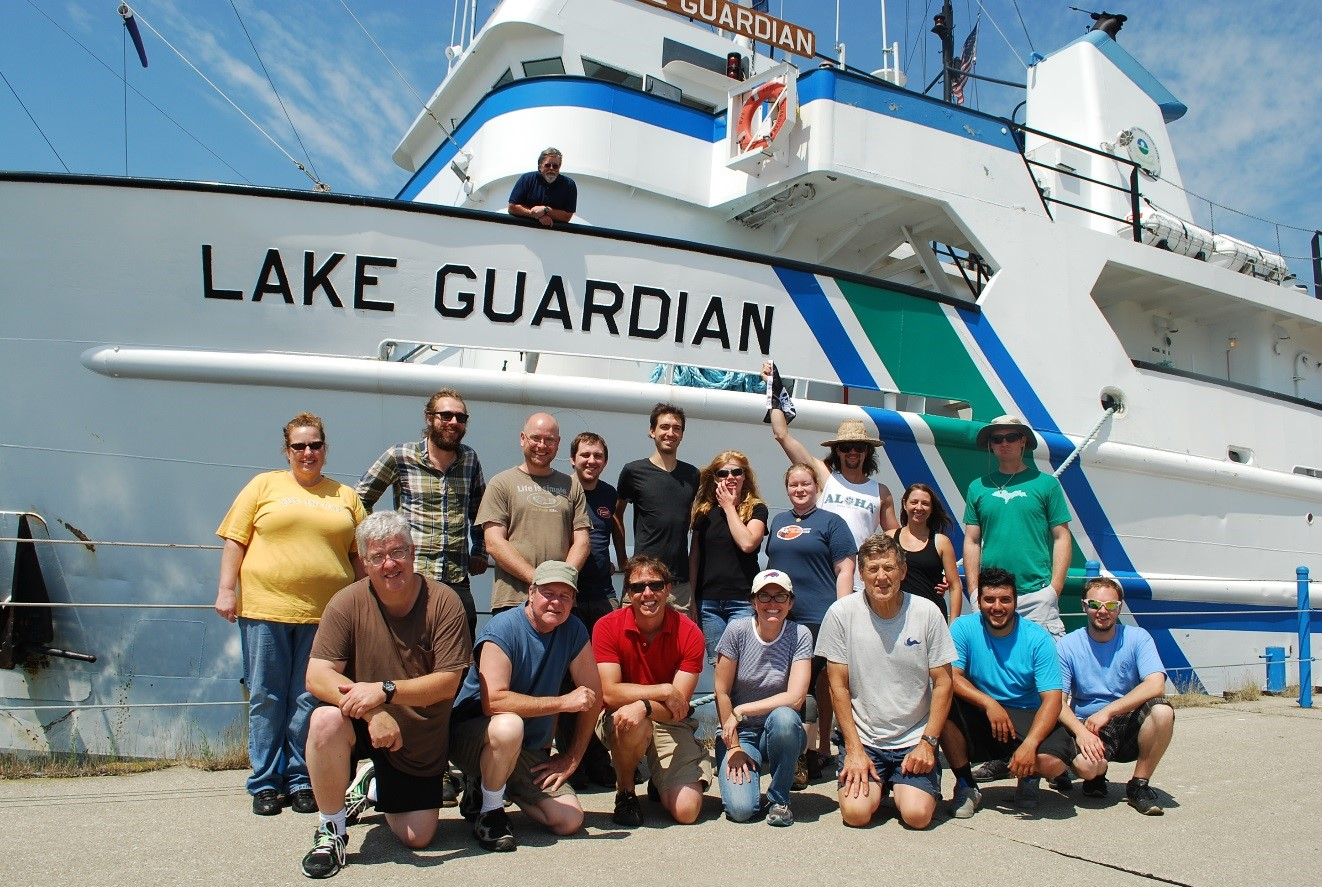 GLC staff and students pose with the staff of the Lake Guardian in front of the 180 foot research vessel